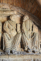 "Early Anglo Saxon sulptures of the Apostles holding books now part of the south porch of Malmesbury Abbey, Wiltshire, England. The apostles, apart from Peter who holds a crude key, have no distinguishing feature to allow identification. Some are holding books, none have halos and some hold their heads at awkward angles. These three styles are typical of Anglo Saxon art. The two panels are 10 ft long and 4ft 6"" high are date from the original Ango Saxon church of 705. They were probablbly built into the proch during the Norman rebuilding. The style of these sculptures is of the Roman Byzantine style and were probably sculpted by masions from Gaul.  Malmesbury Abbey, Wiltshire, England"