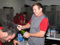 Pawtucket Red Sox pitcher Brock Huntzinger #16 celebrates in the locker room after game four of a best of five playoff series against the Empire State Yankees at Frontier Field on September 8, 2012 in Rochester, New York.  Pawtucket defeated Empire State 7-1 to advance to the International League Finals.  (Mike Janes/Four Seam Images)