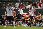 22 August 2009: Chivas USA's Sacha Kljestan (16) is defended by Toronto's Carl Robinson (33). CD Chivas USA played Toronto FC at the Home Depot Center in Carson, California in a regular season Major League Soccer game.
