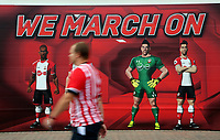 "A Southampton fan walks past a ""We March On"" graffiti outisde the Stadium during the Premier League match between Southampton and Swansea City at the St Mary's Stadium, Southampton, England, UK. Saturday 12 August 2017"