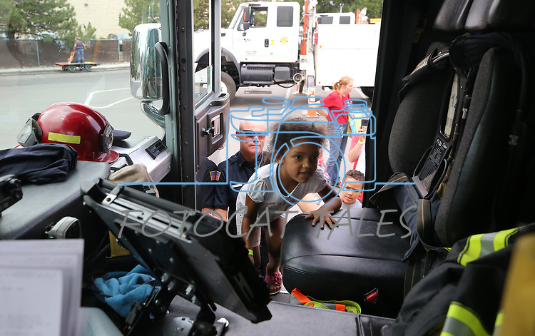 Kelly Penafiel, 5, checks out a Carson City Fire engine during the Touch-a-Truck event at the Carson City Library in Carson City, Nev., on Saturday, Aug. 5, 2017. <br /> Photo by Cathleen Allison/Nevada Photo Source