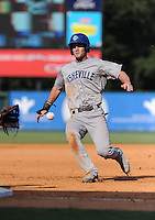 Infielder Samuel Mende (8) of the Asheville Tourists slides safely into third base in a game against the Greenville Drive on Sunday, August 26, 2012, at Fluor Field at the West End in Greenville, South Carolina. Greenville won, 5-4. (Tom Priddy/Four Seam Images)