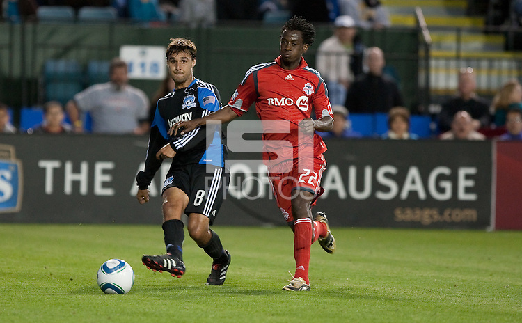 Chris Wondolowski (8) kicks the ball against  Amadou Sanyang (22). Toronto FC defeated the San Jose Earthquakes 3-1 at Buck Shaw Stadium in Santa Clara, California on May 29th, 2010.