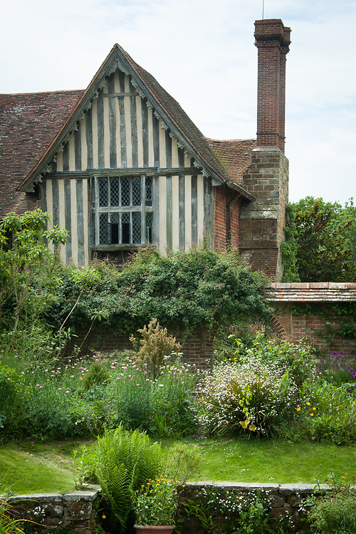 Great Dixter, late May. Looking towards to the northern end of the house from the Sunk Garden.