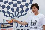 Tokyo governor Yuriko Koike drops an old phone on a recycling box for medals during the 3 Years to Go! ceremony for the Tokyo 2020 Paralympic games at Urban Dock LaLaport Toyosu on August 25, 2017. The Games are set to start on August 25th 2020. (Photo by Rodrigo Reyes Marin/AFLO)