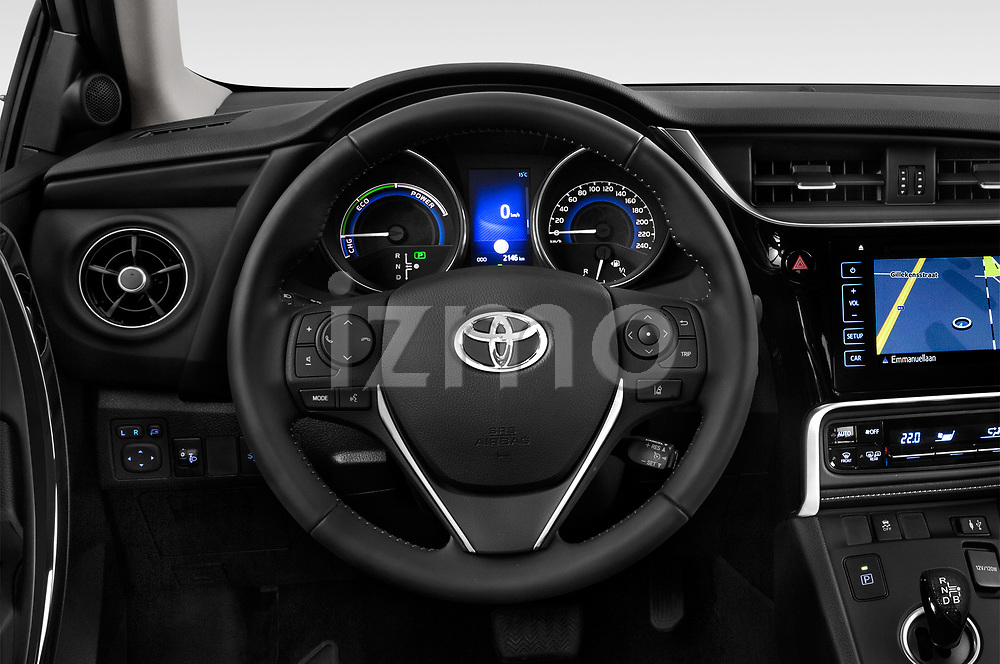 Car pictures of steering wheel view of a 2018 Toyota Auris Hybrid Black Edition 5 Door Hatchback