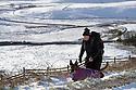 28/01/120<br /> <br /> A dog walker makes her way up to Mam Tor, near Castleton in the Derbyshire Peak District..<br /> <br /> <br /> All Rights Reserved: F Stop Press Ltd.  <br /> +44 (0)7765 242650 www.fstoppress.com