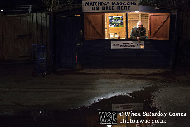 Southend United 1 Burton Albion 1, 22/02/2016. Roots Hall, League One. A programme seller waiting for customers in his cabin outside the ground at Roots Hall stadium, pictured before Southend United took on Burton Albion in a League 1 fixture. Founded in 1906, Southend United moved into their current ground in 1955, the construction of which was funded by the club's supporters. Southend won this match by 3-1, watched by a crowd of 6503. Photo by Colin McPherson.