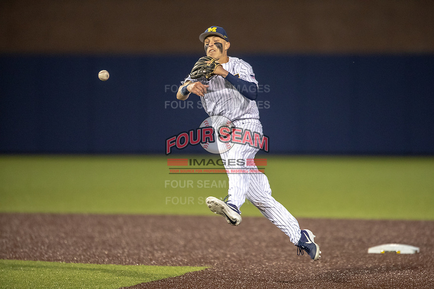 Michigan Wolverines second baseman Blake Nelson (10) makes a throw to first base during the NCAA baseball game against the Eastern Michigan Eagles on May 8, 2019 at Ray Fisher Stadium in Ann Arbor, Michigan. Michigan defeated Eastern Michigan 10-1. (Andrew Woolley/Four Seam Images)