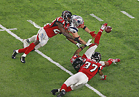 (02/05/2017- Houston, TX) New England Patriots wide receiver Julian Edelman makes a miraculous catch in the fourth quarter besting Atlanta Falcons strong safety Keanu Neal, cornerback Robert Alford , and free safety Ricardo Allen in Super Bowl XLI at NRG Stadium on Sunday, February 5, 2017. Staff Photo by Matt West