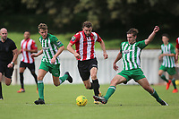 Brad Warner of Hornchurch fights off two Soham defenders during AFC Hornchurch vs Soham Town Rangers, Bostik League Division 1 North Football at Hornchurch Stadium on 12th August 2017