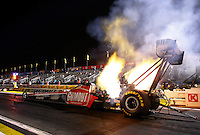 Feb 7, 2014; Pomona, CA, USA; NHRA top fuel dragster driver Leah Pritchett launches off the starting line during qualifying for the Winternationals at Auto Club Raceway at Pomona. Mandatory Credit: Mark J. Rebilas-