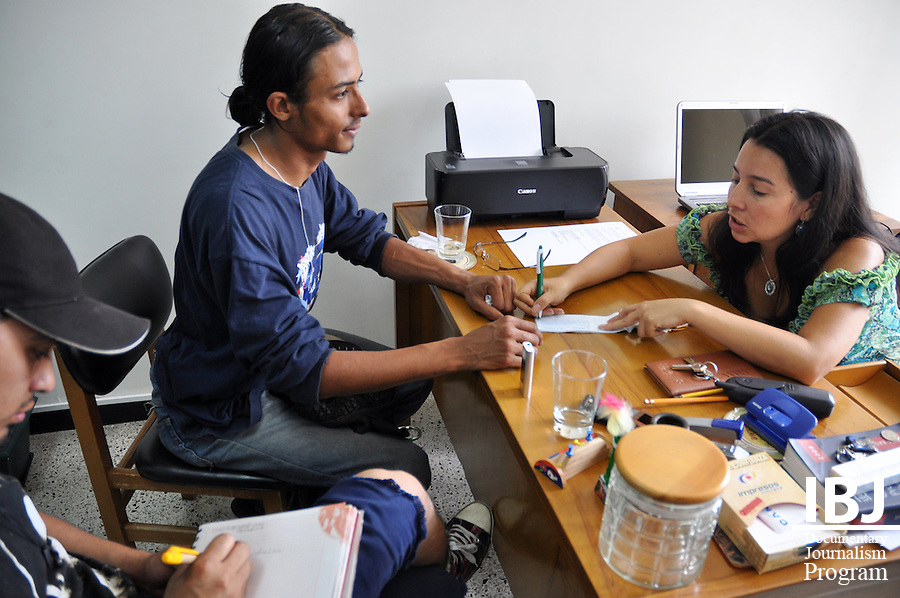 Medell&iacute;n, Colombia - IBJ JusticeMakers Fellow Adriana meets with Diego, a youth who was arbitrarily arrested by anti-riot police; May 20, 2011.<br /> Photo &copy; Siobhan Riordan / IBJ.<br /> www.siobhanriordan.com