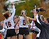 Garden City No. 16 Liana McDonnell, left, and teammates celebrate after their 9-0 win over Manhasset in the Nassau County varsity field hockey Class B final at Adelphi University on Sunday, November 1, 2015.<br /> <br /> James Escher
