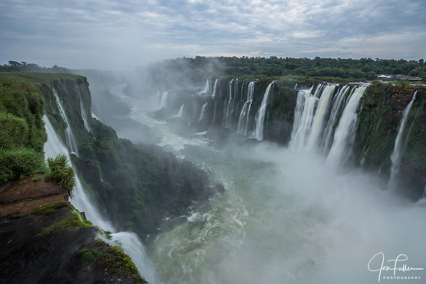 Mist obscures the Iguazu River below the Garganta del Diablo or the Devil's Throat Waterfall in Iguazu Falls National Park in both Argentina and Brazil.  Both parks are UNESCO World Heritage Sites.  The at left is in Argentina with Brazil across the river .