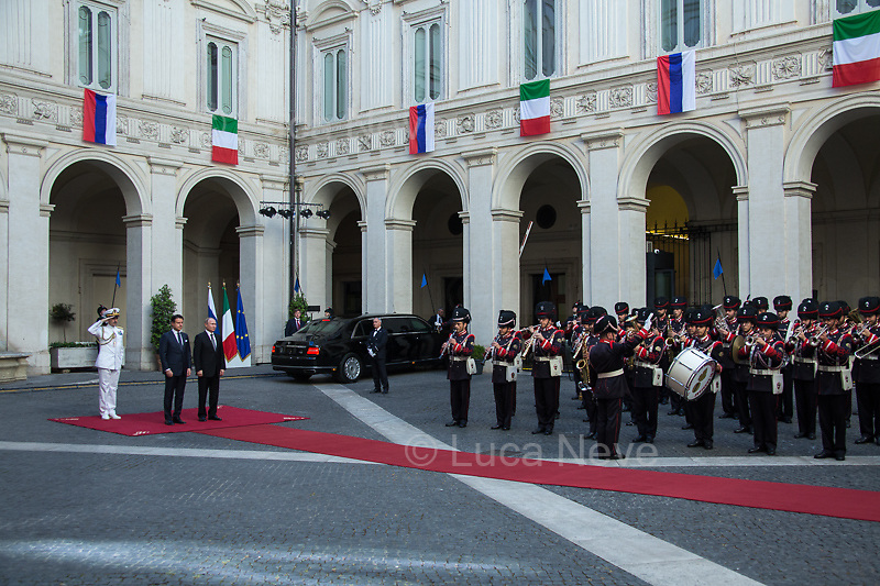 (From R to L) Vladimir Putin, Giuseppe Conte and Admiral Sq. Carlo Massagli (Military Advisor to the Prime Minister and Head of the Secretariat Office).<br /> <br /> Rome, 04/07/2019. Today, the four-time President of the Russian Federation, Vladimir Putin, visited Palazzo Chigi (Official Residence of the Italian Prime Minister and official meeting place of the Council of the Ministers) where he had a private meeting and a press conference with the Italian Prime Minister, Giuseppe Conte. During his visit to Italy, President Putin met Pope Francis, the President of the Italian Republic, Sergio Mattarella, and his old friend and Italian politician, Silvio Berlusconi.<br /> <br /> Footnotes and Links:<br /> For a Video of the Press Conference please click here (Source, Palazzo Chigi on Youtube): https://youtu.be/4Bdssi0L9PI
