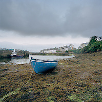 Boat moored in a harbour in Roundstone, Connemara, Ireland