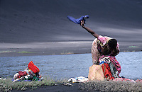 Woman washing clothes on the banks of Siwi Lake, Tanna Island, Vanuatu.
