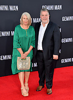 "LOS ANGELES, USA. October 07, 2019: Guy Williams & Diane Williams at the premiere of ""Gemini Man"" at the TCL Chinese Theatre, Hollywood.<br /> Picture: Paul Smith/Featureflash"