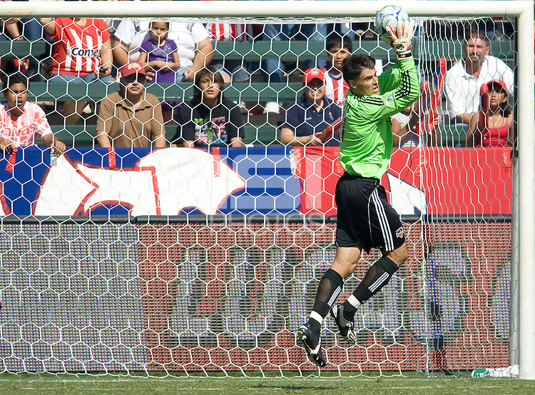 Houston Dynamo goalkeeper Pat Onstad saves a ball. The Houston Dynamo defeated Chivas USA 3-2 at Home Depot Center stadium in Carson, California on Sunday October 25, 2009...