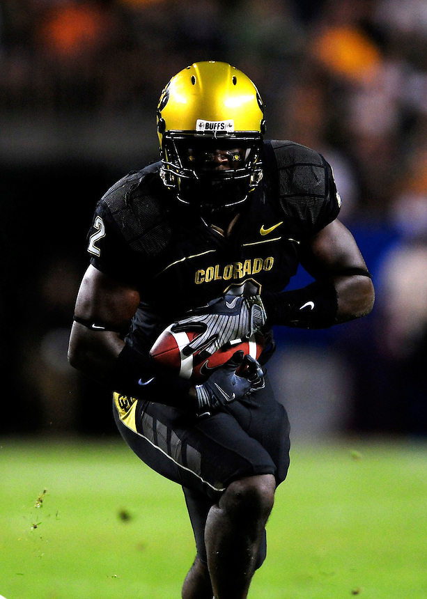 31 Aug 2008: Colorado running back Darrell Scott (2) carries the ball against Colorado State. The Colorado Buffaloes defeated the Colorado State Rams 38-17 at Invesco Field at Mile High in Denver, Colorado. FOR EDITORIAL USE ONLY