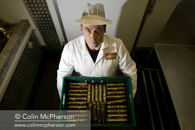 Champion black pudding maker Andy Holt examining samples of his vegetarian black pudding, known as 'v-pud'.  Mr Holt's company, R. S. Ireland, is based in Haslingden, Lancashire, employing around 15 people making over 300 tonnes of black pudding each year.