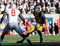 California quarterback Jared Goff runs the ball during the game against Ohio State at Memorial Stadium in Berkeley, California on September 14th, 2013.  Ohio State defeated California, 52-34.