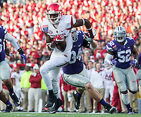 NWA Democrat-Gazette/JASON IVESTER <br /> Arkansas vs Kansas St, Liberty Bowl<br /> Arkansas wide receiver Dominique Reed (87) tries to avoid tackles from Kansas State defenders during the second quarter on Saturday, Jan. 2, 2016, at the Liberty Bowl in Memphis, Tenn.