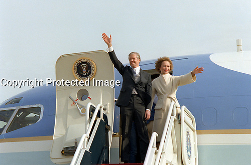 Former President Jimmy Carter and his wife Rosalynn, wave from the top of the aircraft steps as they depart  Andrews Air Force Base at the conclusion of President Ronald Reagan's inauguration ceremony, on January 20, 1981.