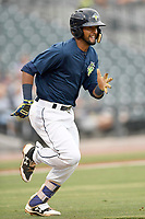 Second baseman Luis Carpio (11) of the Columbia Fireflies runs toward first in a game against the Charleston RiverDogs on Monday, August 7, 2017, at Spirit Communications Park in Columbia, South Carolina. Columbia won, 6-4. (Tom Priddy/Four Seam Images)