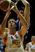 Taranaki's Eli Paurini and Kevin Owens battle for the ball during the NBL Basketball match between Wellington Saints and Devon Dynamos Taranaki at TSB Bank Arena, Wellington, New Zealand on Friday, 11 April 2008. Photo: Dave Lintott / lintottphoto.co.nz