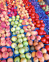 Rows of fruit for sale at Deterings Orchard. Oregon. (Apples, tomatoes, plums, peaches)