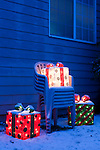 Christmas Present and Stacked Lawn Chairs