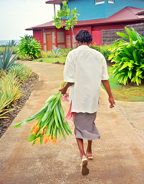 A maid carries flowers to a guest room at <br /> Le Cap Est Lagoon Resort &amp; Spa,Martinique<br /> Carribean.