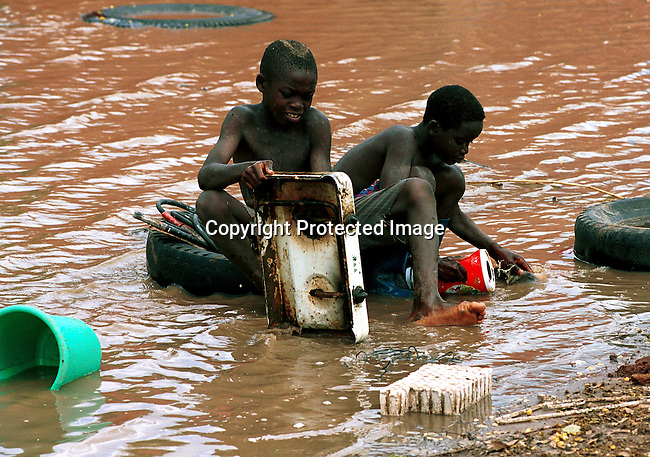 Villagers in Bajjran, Mozambique cleaning up after the severe flooding that hit the country in February-March 2000.  Bajjran was cut off and deliveries of food and other goods was made with boat and helicopter;floods. .©Per-Anders Pettersson/iAfrika Photos