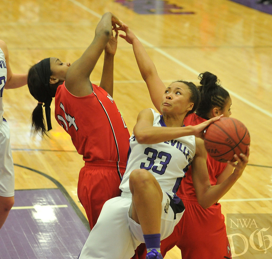 NWA Media/Michael Woods --01/09/2015-- w @NWAMICHAELW... Fayetteville High's  Lauren Holmes (33) tries to drive to the hoop past Fort Smith Northside defenders Kira Shepard (5) and Tiarra McDonald (24) during Friday nights game in Fayetteville