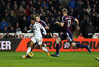 Saturday 19 January 2013<br /> Pictured L-R: Jonathan de Guzman of Swansea scoring his second goal, Robert Huth and Ryan Shawcross of Stoke were unable to stop him.<br /> Re: Barclay's Premier League, Swansea City FC v Stoke City at the Liberty Stadium, south Wales.