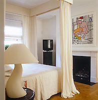Roy Lichtenstein's Two Nudes hangs above the fireplace in the master bedroom