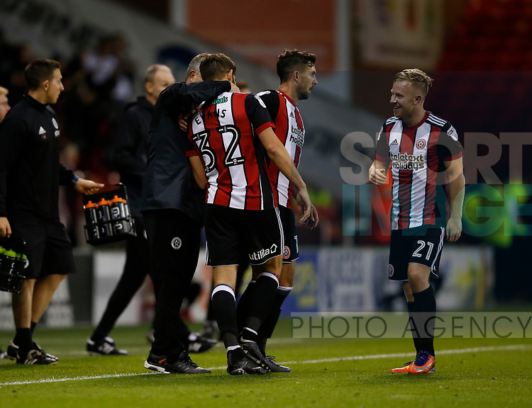 Chris Wilder manager of Sheffield Utd hugs goal scorer Ched Evans of Sheffield Utd during the Carabao Cup First Round match at Bramall Lane Stadium, Sheffield. Picture date: August 9th 2017. Pic credit should read: Simon Bellis/Sportimage