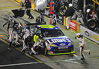 Oct. 17, 2009; Concord, NC, USA; NASCAR Sprint Cup Series driver Jimmie Johnson pits during the NASCAR Banking 500 at Lowes Motor Speedway. Mandatory Credit: Mark J. Rebilas-