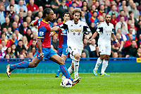 Sun 22 September 2013<br /> <br /> Pictured: Cameron Jerome of Crystal Palace tries to get the ball past Jose Canas  of Swansea<br /> <br /> Re: Barclays Premier League Crystal Palace FC  v Swansea City FC  at Selhurst Park, London
