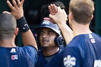 New Orleans Zephyrs third baseman Donovan Solano (17) is greeted in the dugout after he scored during the Pacific Coast League baseball game against the Round Rock Express on June 30, 2013 at the Dell Diamond in Round Rock, Texas. Round Rock defeated New Orleans 5-1. (Andrew Woolley/Four Seam Images)
