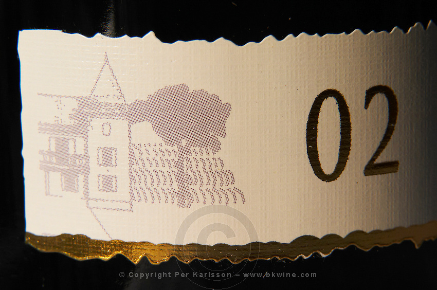 detail of label with a drawing of a chateau and the numbers 02 Cahors Lot Valley France