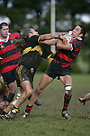 T. Panga tries to fend off Q. Capewell. Counties Manukau Premier 2 Championship game between Bombay and Papakura played at Bombay on May 13th, 2006. Papakura won 8 - 7.