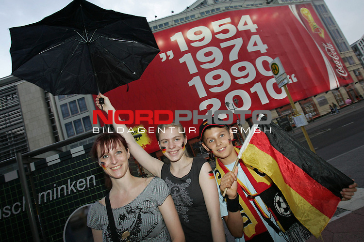 FIFA WM 2006 - Feature Fanmeile Berlin<br /> Play #63 (08-Jul) - Germany vs Portugal.<br /> Supporters from Germany in front of transparent (1954, 1974, 1990 and 2010) prior to the match Germany against Portugal at Potsdamer Platz in Berlin.<br /> Foto &copy; nordphoto