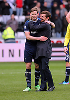 Pictured: Andre Villas Boas manager of Tottenham (R) hugs one of his players at the end of the game. Saturday 30 March 2013<br />