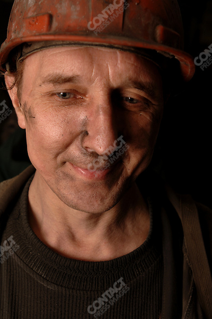A miner in the Taimirsky Mine in Talnakh, the mining town near Norilsk, that supplies the ore for Norilsk's factories at the end of his shift. June 14, 2007