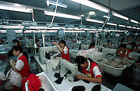 Underwear garment workers churn out bras at the Meisi Underwear Factory in Nanhai, Guangdong, China. The city of Nanhai is China's underwear manufacturing center. .07-SEP-01