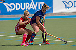 GER - Mannheim, Germany, April 15: During the field hockey 1. Bundesliga match between Mannheimer HC (blue) and Rot-Weiss Koeln (red) on April 15, 2018 at Am Neckarkanal in Mannheim, Germany. Final score 2-1.  Hannah Gablac #4 of Rot-Weiss Koeln, Nike Lorenz #16 of Mannheimer HC<br /> <br /> Foto &copy; PIX-Sportfotos *** Foto ist honorarpflichtig! *** Auf Anfrage in hoeherer Qualitaet/Aufloesung. Belegexemplar erbeten. Veroeffentlichung ausschliesslich fuer journalistisch-publizistische Zwecke. For editorial use only.