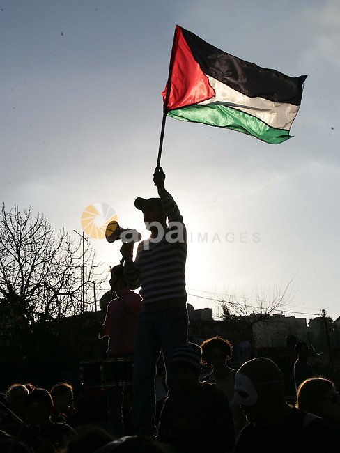 Palestinian left-wing activists attend a protest near a disputed house in the east Jerusalem neighborhood of Sheikh Jarrah, Friday, Jan. 1, 2010. Photo by Mohamar Awad
